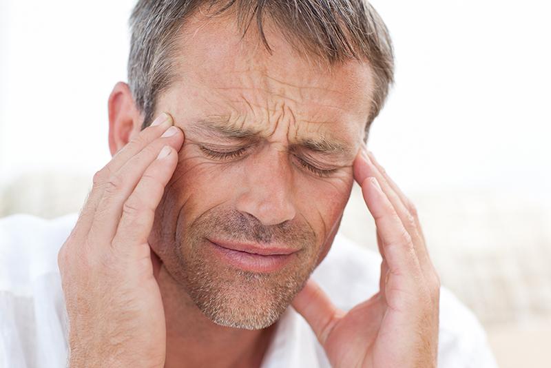 Man having tinnitus pain at home